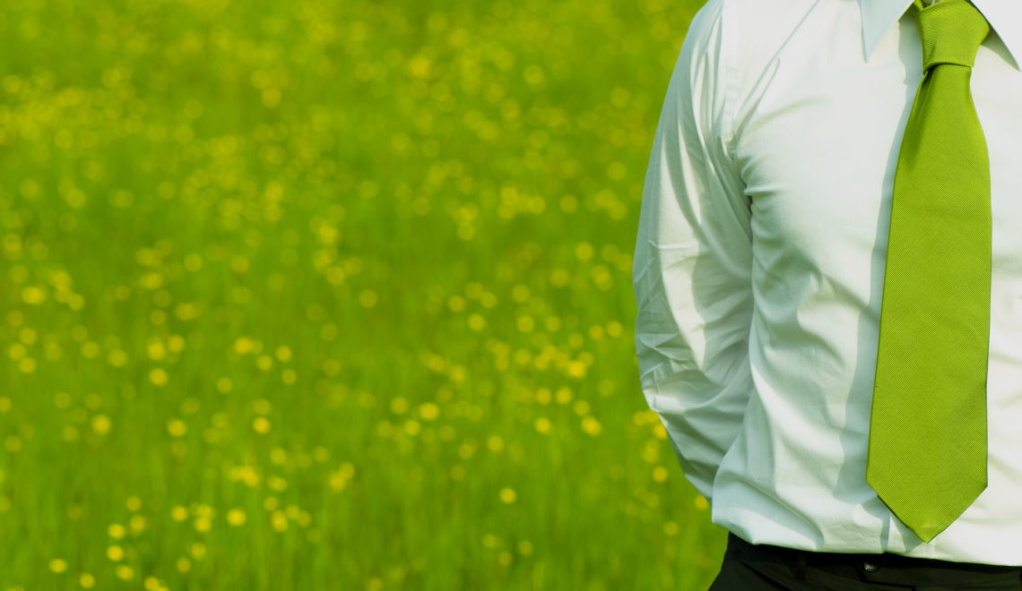 business manager outdoor with green necktie